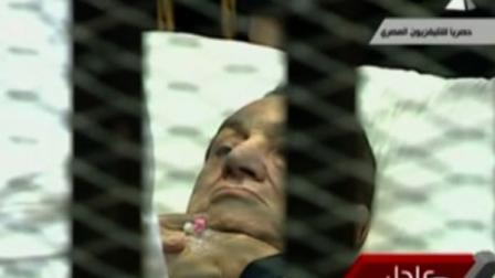 An ailing, 83-year-old Hosni Mubarak, is seen on a hospital bed inside a metal defendants cage at his historic trial on Monday, Aug. 15, 2011.