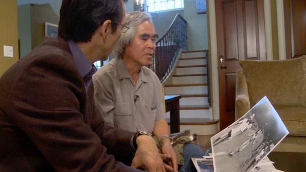 Los Angeles Associated Press photographer Nick Ut and Eyewitness News Anchor David Ono look at a photo.
