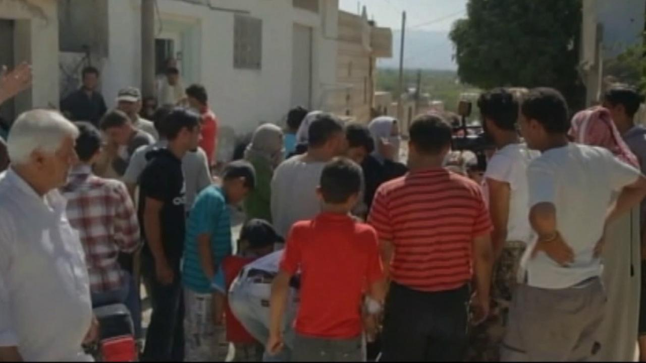 A crowd of people gather on a street in Syria in this July 2012 photo. On Sunday, July, 15, 2012, the international Red Cross officially declared the conflict in Syria a civil war.