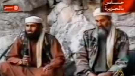 This still from a video aired on Oct. 7, 2001, shows al Qaeda spokesman Suleiman Abu Ghaith, left, speaking while sitting next to Osama bin Laden at an undisclosed location in Afghanistan.