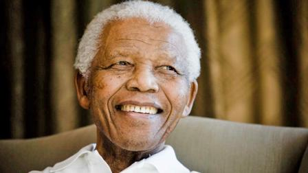 Former South African President Nelson Mandela smiles at the Mandela foundation, in Johannesburg, South Africa, Tuesday June 2, 2009.