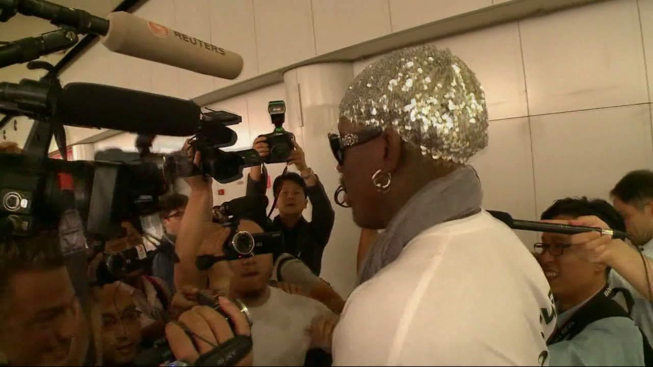 Retired NBA star Dennis Rodman, center, talks to journalists upon arriving at the Beijing capital airport in Beijing, China, Saturday, Sept. 7, 2013.