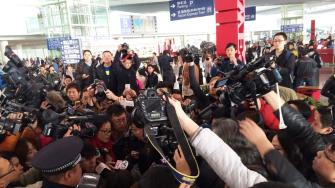 In this photo released by Chinas Xinhua News Agency, reporters crowd at Terminal 3 of Beijing Capital International Airport in Beijing, China Saturday, March 8, 2014.