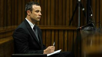 Oscar Pistorius sits in the dock and listens to cross questioning about the events surrounding the shooting death of his girlfriend Reeva Steenkamp, in court during his trial in Pretoria, South Africa, Tuesday, March 11, 2014.