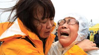 Relatives of a passenger aboard a sunken ferry weep as they wait for the news on the rescue operation, at a port in Jindo, South Korea, Thursday, April 17, 2014.