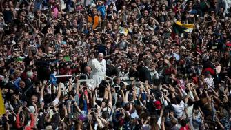 Pope Francis drives through the crowd after celebrating an Easter Mass in St. Peters Square, at the the Vatican, Sunday, April 20, 2014.