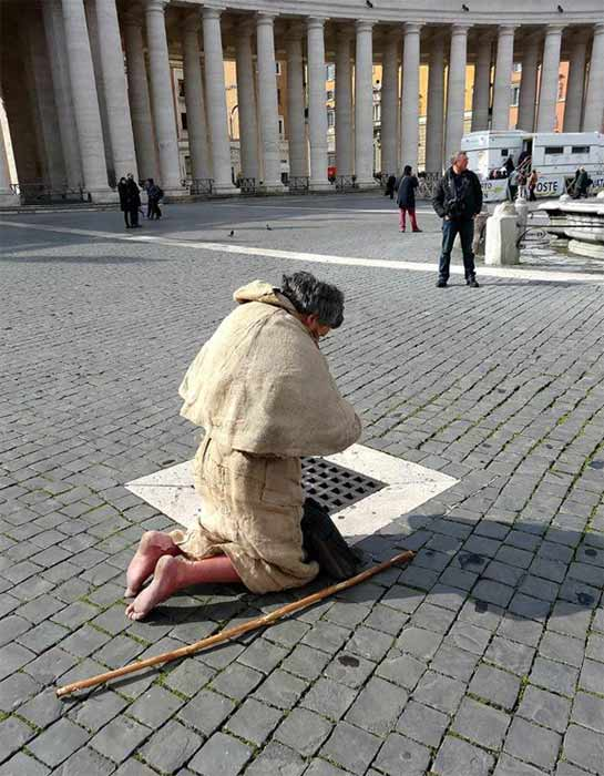 A man prays in St. Peter&#39;s Square in Vatican City ahead of the pope conclave on Tuesday, March 12, 2013. <span class=meta>(KABC)</span>
