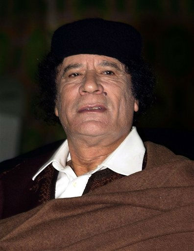 Libyan leader Moammar Gadhafi looks on during his meeting with Canadian Prime Minister Paul Martin, not pictured, upon his arrival in Tripoli, Libya, Sunday, Dec. 19, 2004.  <span class=meta>(AP Photo&#47; Yousef al-Ageli)</span>