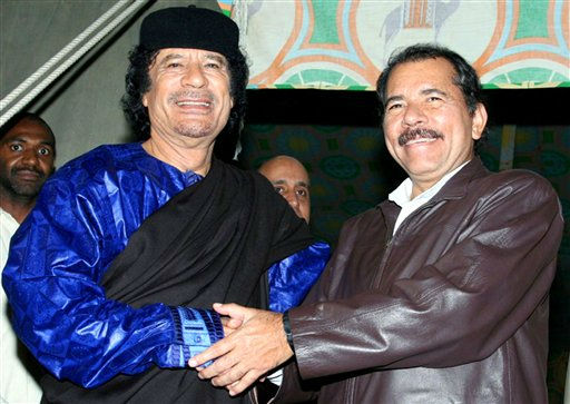 In this handout photo released by Presidential House of Nicaragua,  Libyan leader Moammar Gadhafi, left, shakes hands with Nicaragua&#39;s President Daniel Ortega during a meeting in Tripoli, Libya, Tuesday, June 5, 2007. <span class=meta>(AP Photo&#47; Jairo Cajina)</span>