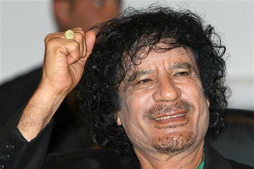 Libyan leader Col. Moammar Gadhafi gestures while visiting the UNESCO headquarters on the second day of his six-day visit, Paris, Tuesday, Dec. 11, 2007.  <span class=meta>(AP Photo&#47;Jacky Naegelen)</span>