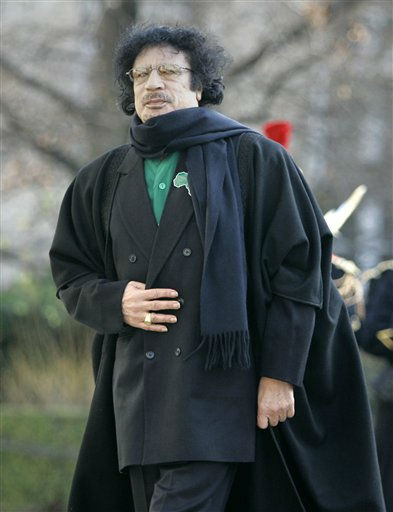 "<div class=""meta ""><span class=""caption-text "">Libyan leader Moammar Gadhafi walks before meeting with lawmakers from France's lower house of Parliament, Tuesday, Dec.11, 2007 in Paris.  (AP Photo/ Christophe Ena)</span></div>"