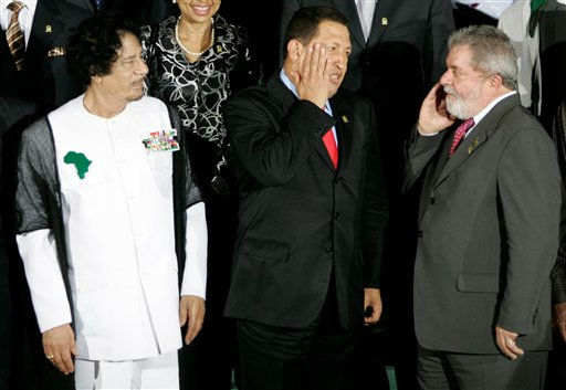 "<div class=""meta image-caption""><div class=""origin-logo origin-image ""><span></span></div><span class=""caption-text"">Brazil's President Luiz Inacio Lula Da Silva, right, speaks to Venezuela's President Hugo Chavez, center, as Libya's President Moammar Gadhafi looks at them during the official photo at the Africa and South America Summit, ASA, in Porlamar, Margarita Island, Venezuela, Saturday, Sept. 26, 2009.  (Photo/Fernando Llano)</span></div>"