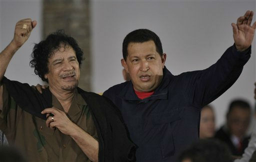 Libya&#39;s President Moammar Gadhafi, left, and Venezuela&#39;s President Hugo Chavez wave upon their arrival to the old port in Porlamar, on Margarita Island, Venezuela, Monday, Sept. 28, 2009.  <span class=meta>(AP Photo&#47; Fernando Llano)</span>