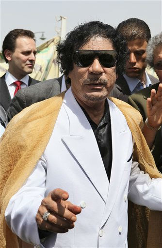 "<div class=""meta ""><span class=""caption-text "">Libyan leader Moammar Gadhafi gestures after meeting with Greece's prime minister George Papandreou, not pictured, during a one-day official visit by  Papandreou to the North African country, in Tripoli, Libya, Wednesday, June 9, 2010.  (AP Photo/ Abdel Meguid al-Fergany)</span></div>"