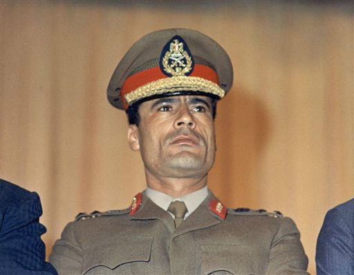 "<div class=""meta ""><span class=""caption-text "">Moammar Gadhafi, Libyan strongman at the Cairo Airport in 1970.  (AP Photo)</span></div>"