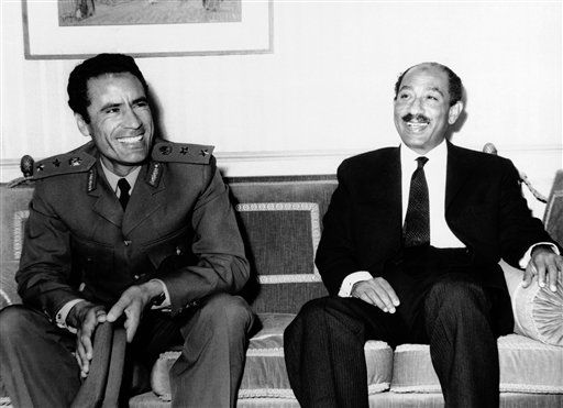 United Arab Republic President Anwar Sada, right, and Lybian Moammar Gadhafi, pause during their meeting in Cairo on Tuesday, April 13, 1971.  <span class=meta>(AP Photo)</span>