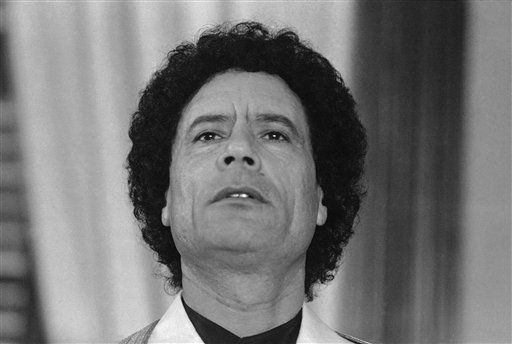 "<div class=""meta ""><span class=""caption-text "">Libyan leader Moammar Gadhafi  smiles during a press conference at Palma de Mallorca, Spain on Thursday, Dec. 20, 1984.  (AP Photo/ Mollard)</span></div>"