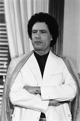 "<div class=""meta image-caption""><div class=""origin-logo origin-image ""><span></span></div><span class=""caption-text"">Libyan leader Moammar Gadhafi  smiles during a press conference at Palma de Mallorca, Spain Thursday, Dec. 20, 1984.  (AP Photo/ Mollard)</span></div>"