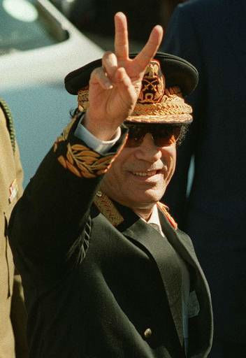 "<div class=""meta ""><span class=""caption-text "">Libyan leader Moammar Gadhafi, makes a peace sign as he arrives for the inauguration ceremony for South African President Thabo Mbeki in Pretoria, South Africa, Wednesday, June 16, 1999.    (AP Photo/ THEMBA HADEBE)</span></div>"