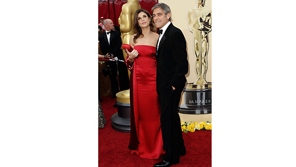 George Clooney and Elisabetta Canalis arrives during the 82nd Academy Awards Sunday, March 7, 2010.