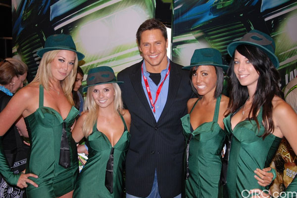 OTRC's Chris Balish is seen with 'Green Hornet' girls at Comic-Con in San Diego during preview night, Wednesday, July 21, 2010.