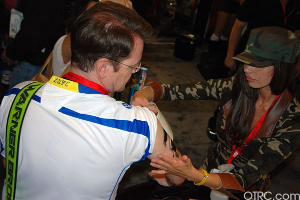 An attendee gets 'The Expendables' temporary tattoo at Comic-Con 2010 in San Diego