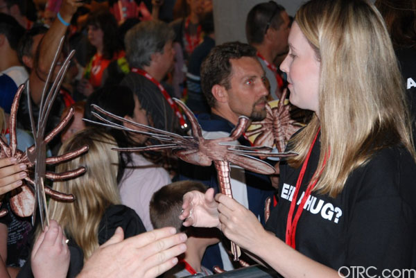 'Alien' fans show off their 'facehugger' handouts at Comic-Con 2010 in San Diego