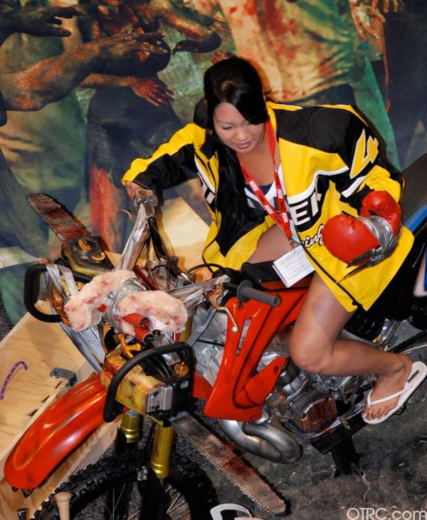 A fan poses on a motorcycle at Comic-Con 2010 in San Diego