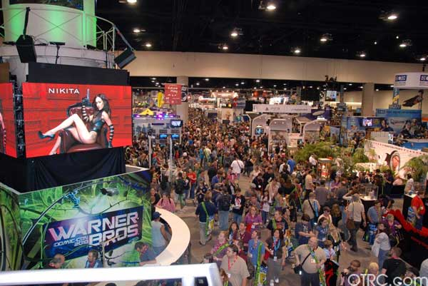 Fans swarm around the Warner Bros. exhibit booth at Comic-Con 2010 in San Diego