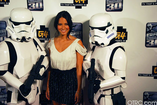 &#39;Attack of the Show&#39; host and actress Olivia Munn poses with Storm Troopers at a G4 party at Comic-Con in San Diego on Thursday, July 22, 2010. <span class=meta>(KABC)</span>