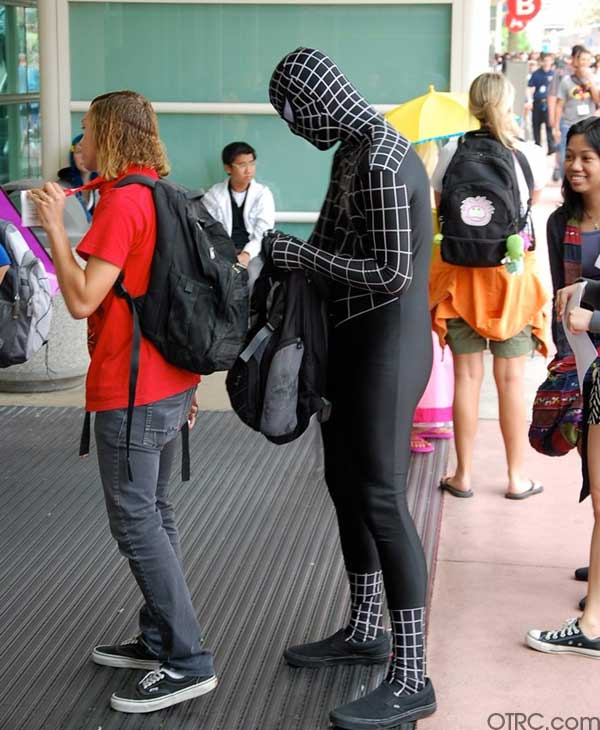 A fan dressed as Spider-Man is seen waiting in...