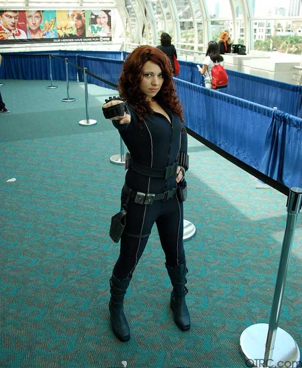 "<div class=""meta ""><span class=""caption-text "">This Comic-Con attendee is dressed up as Scarlett Johansson's character from 'Iron Man 2' Natasha Romanoff/Black Widow</span></div>"