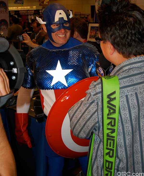 A fan dressed as Captain America is interviewed...