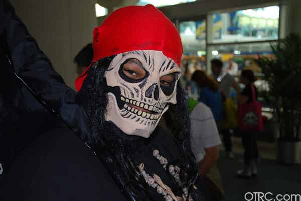 A fan with a skull mask is seen at Comic-Con in...