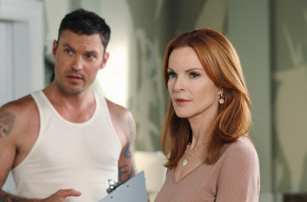 Marcia Cross and Brian Austin appear in a scene...