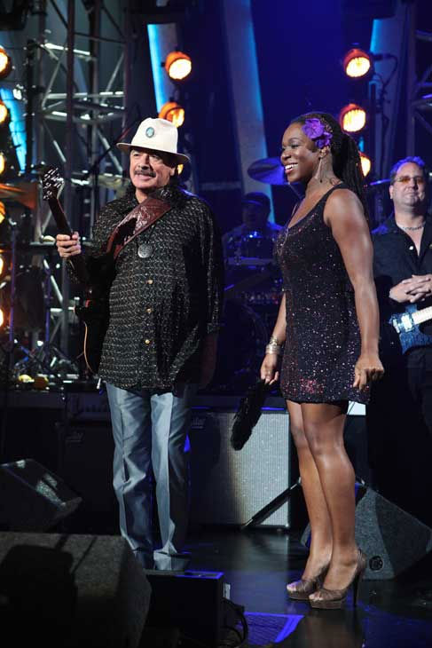 Santana, headed by guitarist Carlos Santana,...