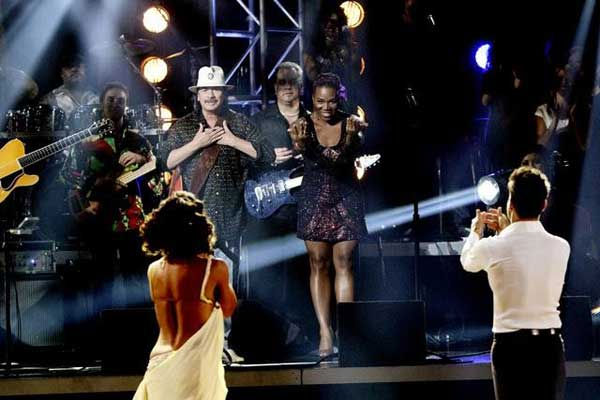 "<div class=""meta image-caption""><div class=""origin-logo origin-image ""><span></span></div><span class=""caption-text"">Santana, headed by guitarist Carlos Santana, performed with India.Arie on 'Dancing With the Stars: The Results Show,' Tuesday, Sept.  21, 2010. (ABC Photo/ Adam Larkey)</span></div>"