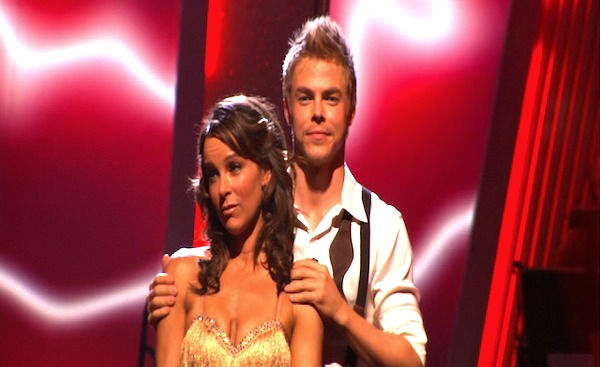 Jennifer Grey and Derek Hough wait to hear their...