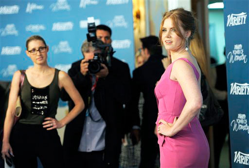 Honoree Amy Adams, right, poses for...