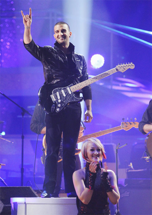 Mark Ballas and Val Chmerkovskiy (not pictured) had a string duel to a rendition of Britney Spears' 'Toxic' on 'Dancing With the Stars: The Results Show,' Tuesday, Oct. 5, 2010.