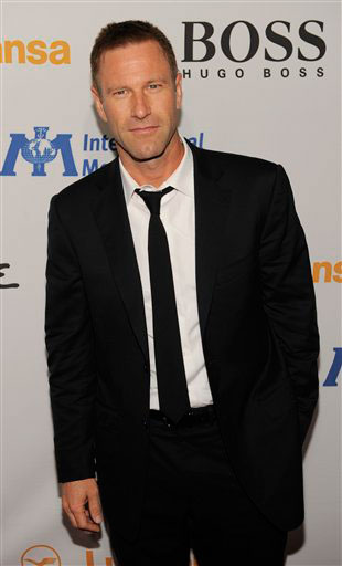Aaron Eckhart arrives at the Esquire House LA...