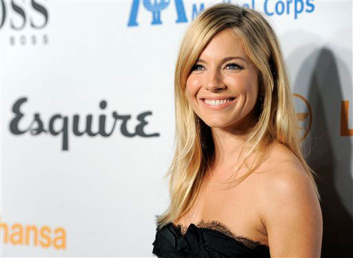 Host Sienna Miller arrives at the Esquire House LA Opening Night Event and International Medical Corps Benefit in Beverly Hills, Calif., Friday, Oct. 15, 2010.