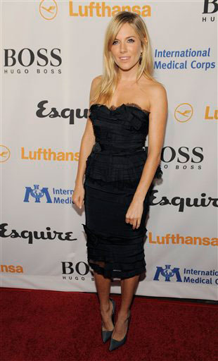 Host Sienna Miller arrives at the Esquire House...