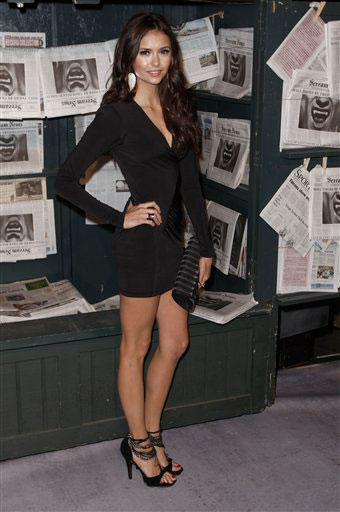 "<div class=""meta ""><span class=""caption-text "">Nina Dobrev arrives at the Scream Awards on Saturday Oct. 16, 2010, in Los Angeles.  (AP Photo/Chris Pizzello)</span></div>"