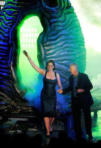 Sigourney Weaver is seen on stage as she accepts the award for 'Heroine' from presenter James Cameron at the Scream Awards on Saturday Oct. 16, 2010, in Los Angeles.