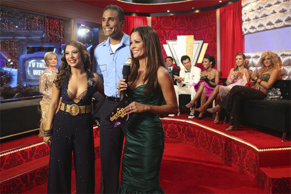 Rick Fox and Cheryl Burke, with host Brooke Burke, wait to hear their scores from the judges after performing to the 'Hill Street Blues' theme on 'Dancing With the Stars,' Monday, Oct. 18, 2010. The judges gave the couple 24 points out of 30.