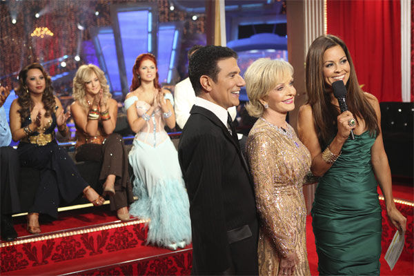 Florence Henderson and Corky Ballas, with host Brooke Burke, wait to hear their scores after performing to 'The Brady Bunch' theme on 'Dancing With the Stars,' Monday, Oct. 18, 2010. The judges gave the couple 21 points out of 30.