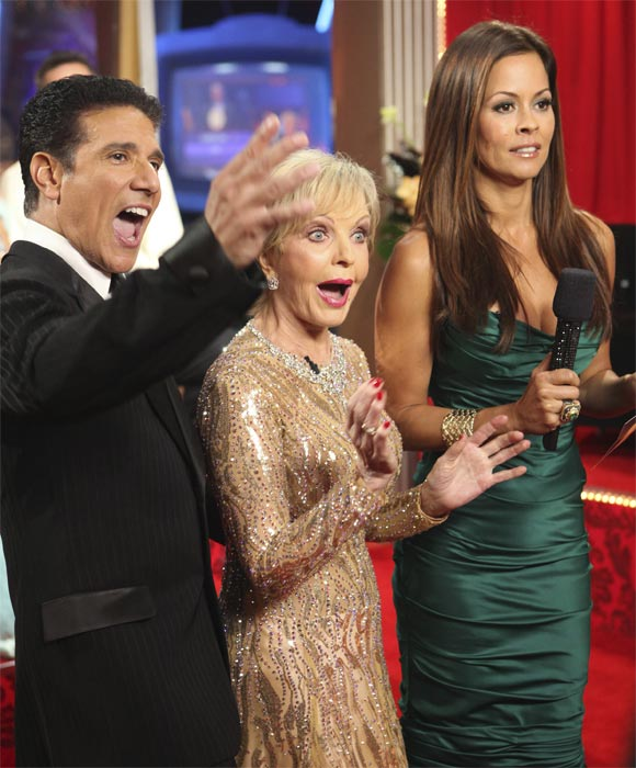 Florence Henderson and Corky Ballas, with host Brooke Burke, react after hearing their scores for their performance to 'The Brady Bunch' theme on 'Dancing With the Stars,' Monday, Oct. 18, 2010. The judges gave the couple 21 points out of 30.