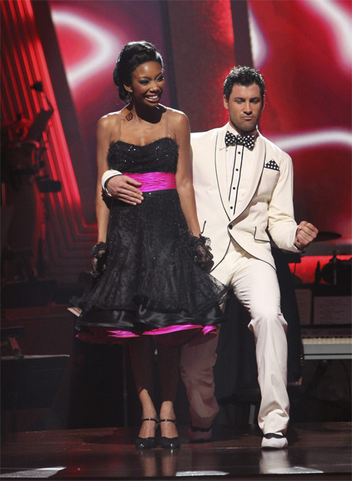 Brandy and Maksim Chmerkovskiy react to being safe on 'Dancing With the Stars: The Results Show,' Tuesday, Oct. 19, 2010. The judges gave the couple 27 points out of 30.