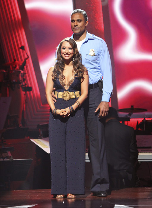 "<div class=""meta ""><span class=""caption-text "">Rick Fox and Cheryl Burke wait to hear their fate on 'Dancing With the Stars: The Results Show,' Tuesday, Oct. 19, 2010. The judges gave the couple 24 points out of 30. (ABC Photo/Adam Larkey)</span></div>"